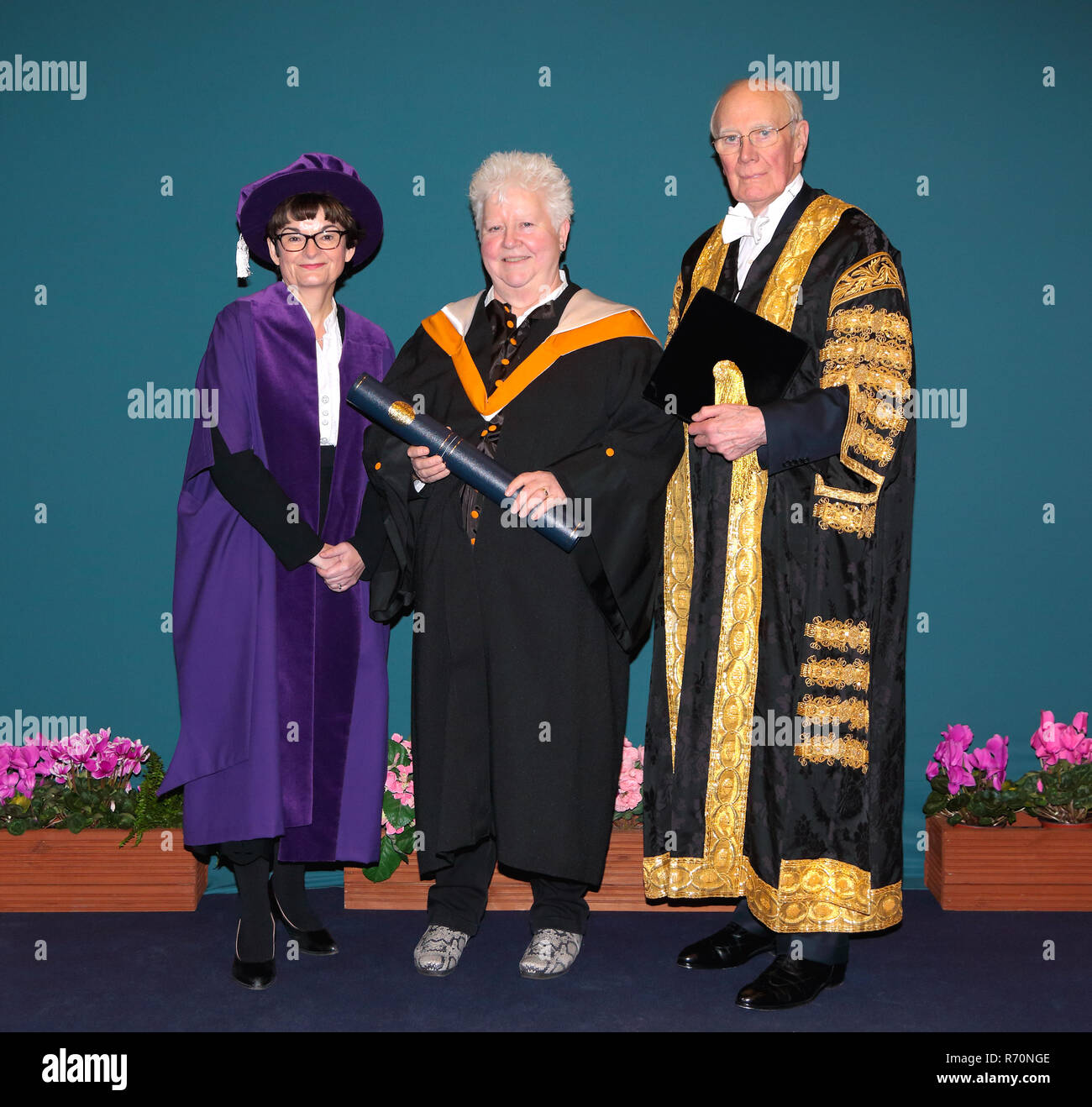 St Andrews, Fife, Scotland. 7th December 2018. St Andrews University Fife, Scotland, UK, Val McDermid recieves her Honorary degree from Professor Sally Mapstone the Principal and Vice-Chancellor standing alongside Sir Menzies Campbell. Credit: Derek Allan/Alamy Live News - Stock Image