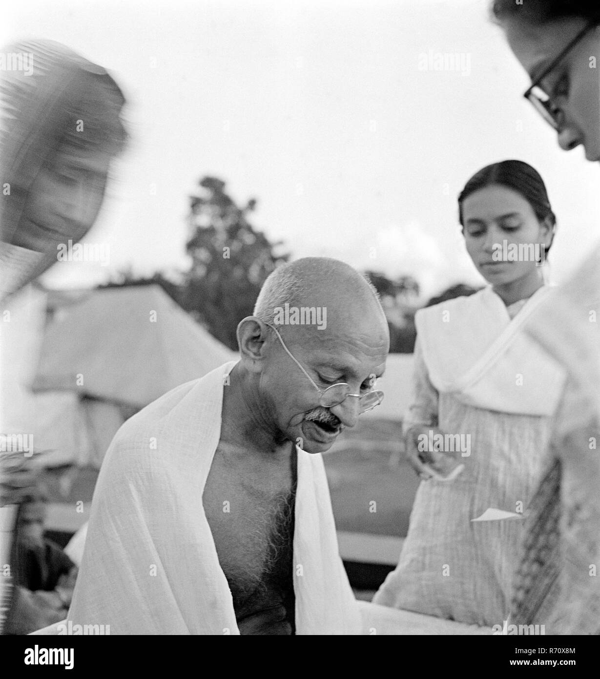 Mahatma Gandhi giving an autograph on his 75th birthday at Pune, Maharashtra, India, October 2, 1944 - MODEL RELEASE NOT AVAILABLE - Stock Image