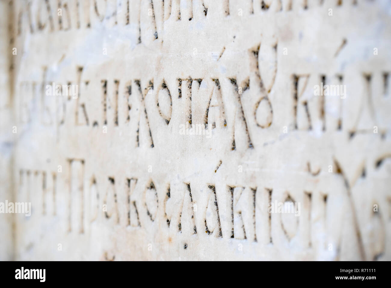 Fragment of the Cyrillic Old Slavic letter on the wall in the temple. Selected focus - Stock Image