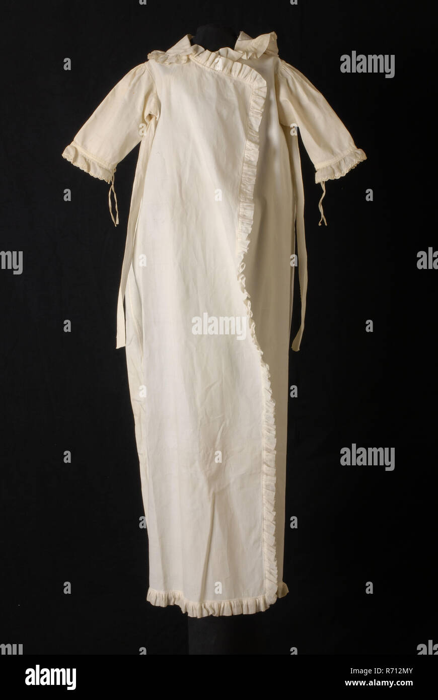 bffe872edd72 Long white baby coat of rib cotton, piqué, trimmed along all edges with  ruffles