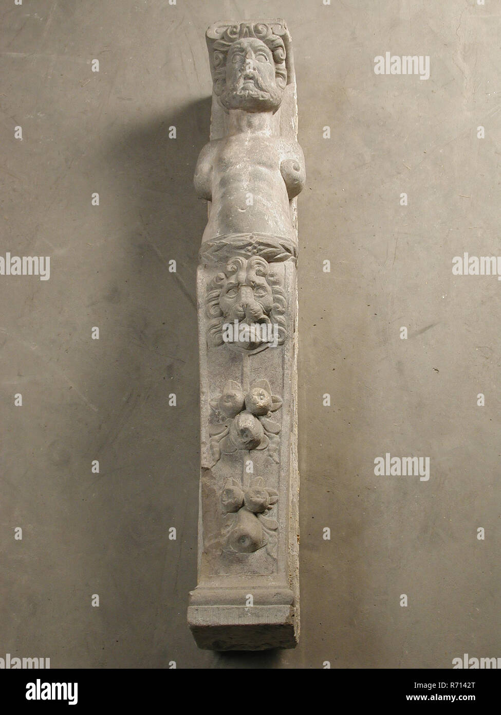 Atlant with ionic capital, atlant building element sculpture footage sandstone stone, sculpted Atlant with Ionic capitals man with beard Arms abstracted to curl around the waist leaf. Lower half is column: at the top lion's head in the middle fruit. - Stock Image