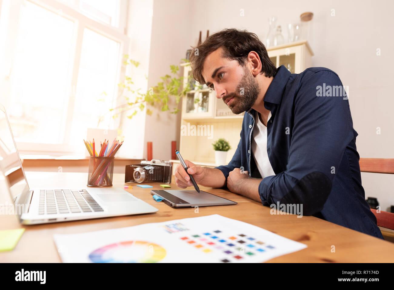 Graphic Designer Working On Digital Tablet Freelancer Working At