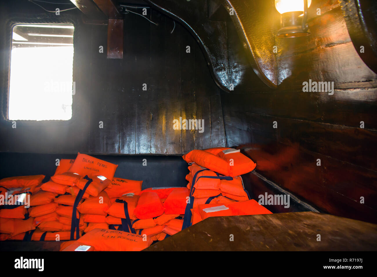 orange life vest on wooden background - Stock Image