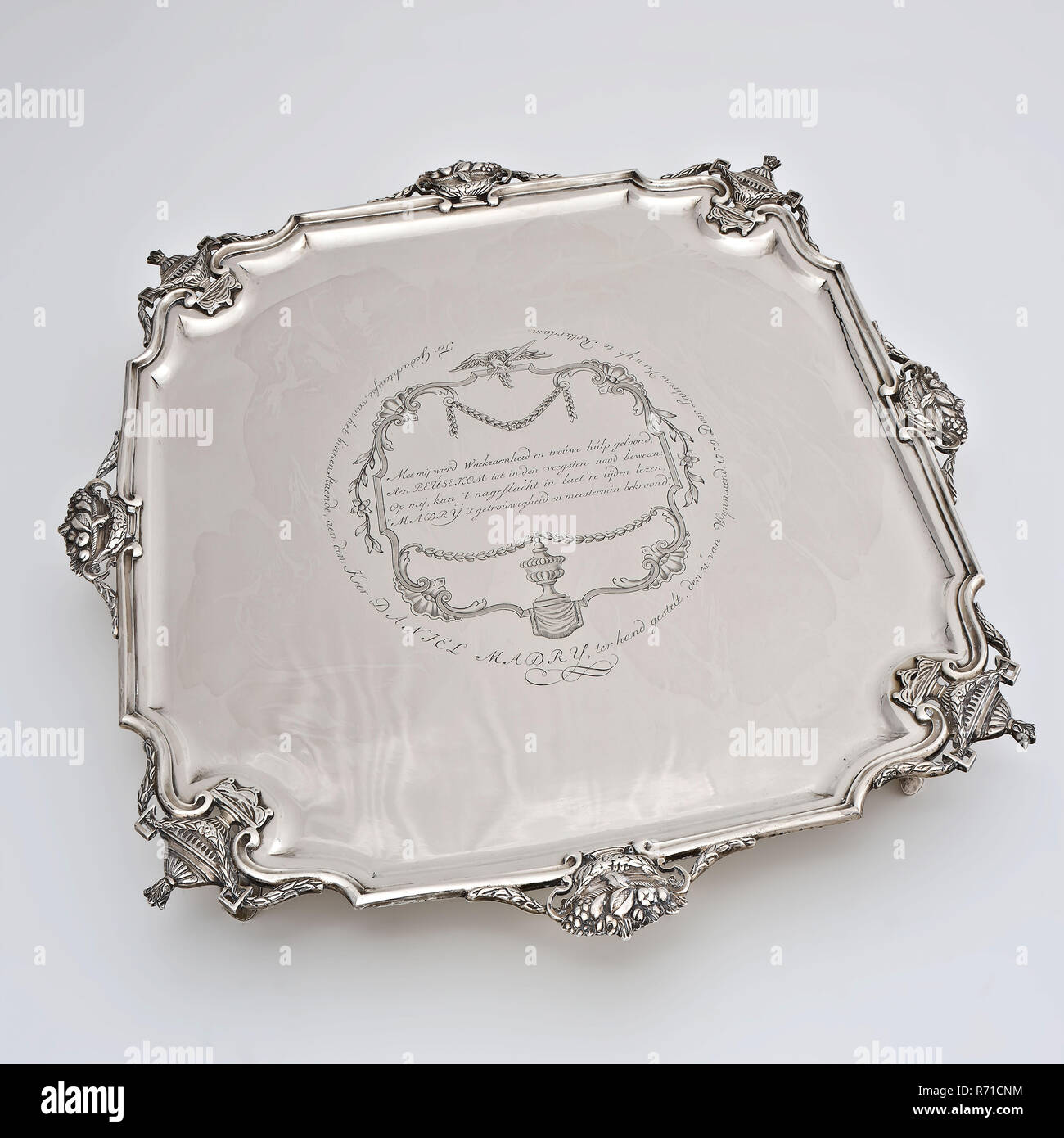 Silversmith: Douwe Eysma, Silver tray on legs with inscription, tray leaf holder silver, cast engraved Square leaf with bevelled corners on four smooth legs bottom bottom (smashed) Rotterdam Scheepmakershaven tobacco fire serve remember Louis XVI Louis XVI Louis Seize The magazine was Madry (1752-1808) donated because of the help he gave as 27-year-old servant to tobacco dealer Van Beusekom in the rescue of bales of tobacco during the fire at the Scheepmakershaven on 1011 March 1779. - Stock Image