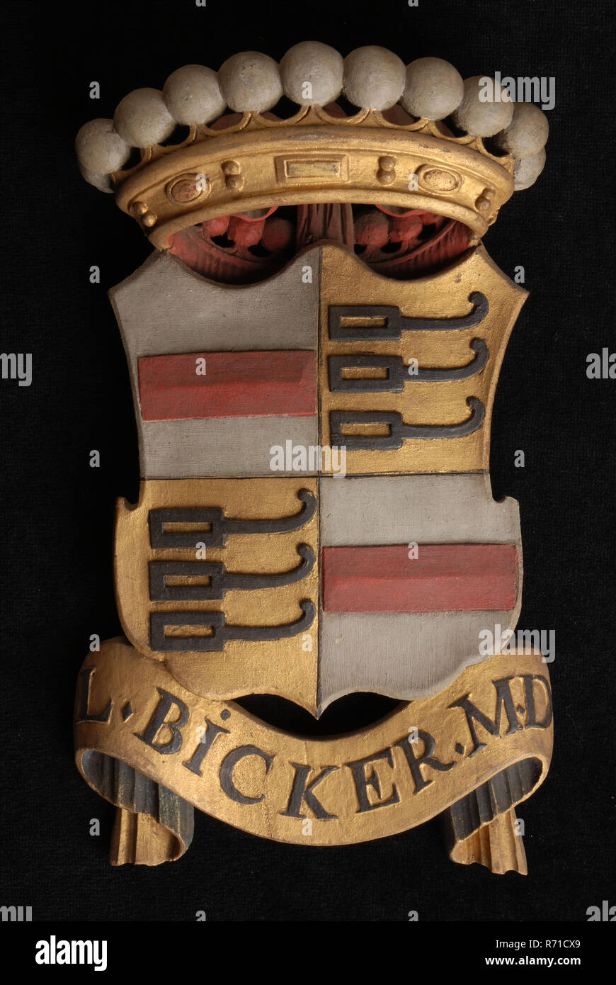 Carved wooden crowned coat of arms including the name l. bicker. m.d