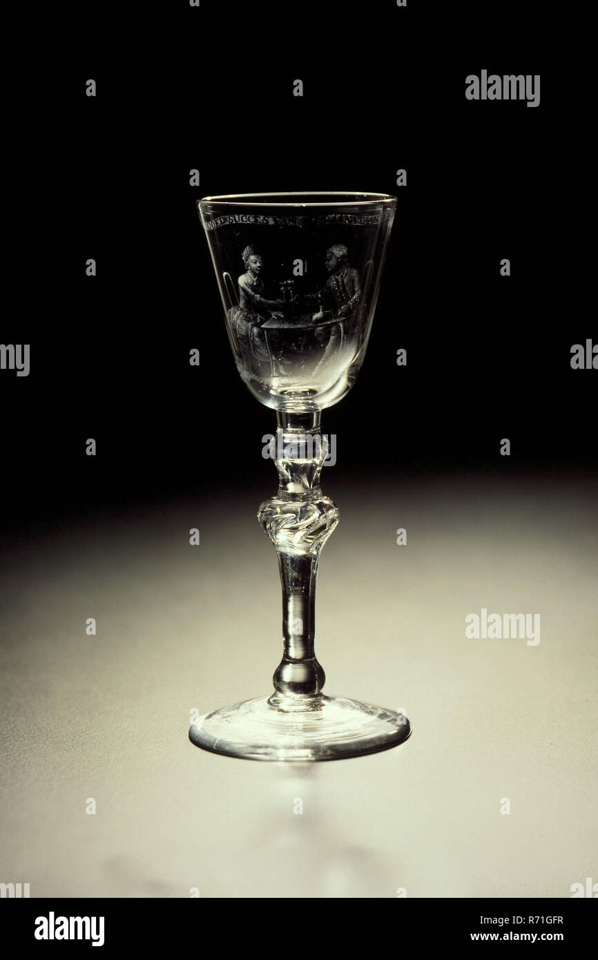 Chalice with dot engraving of each pair, with the inscription THE GOOD SUCCESS OF THE UPCOMING WEDDING, wine glass drinking glass drinking utensils tableware holder glass lead glass, gram free blown and shaped stipgraving Goblet wineglass in clear colorless lead glass Pontil mark under round light ascending hollow base Two-part solid reverse balustere bottom part: convex knot to baluster knot with six elongated air bubbles passing through; upper part: convex knot with enclosed drop-shaped air bubble. Bottom rounded funnel-shaped chalice with fire-rounded rim Chalice carved in dotted banderole  - Stock Image