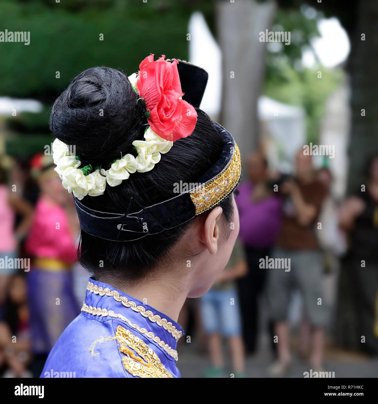 Lateral view of a young woman wearing one of the folk costume of Indonesia - Stock Image