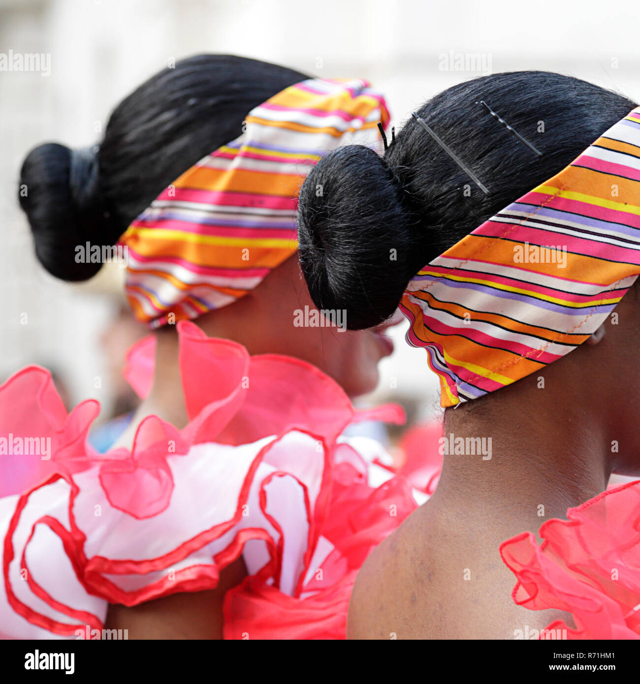 Lateral view of two young woman wearing one of the folk costume of Cuba - Stock Image
