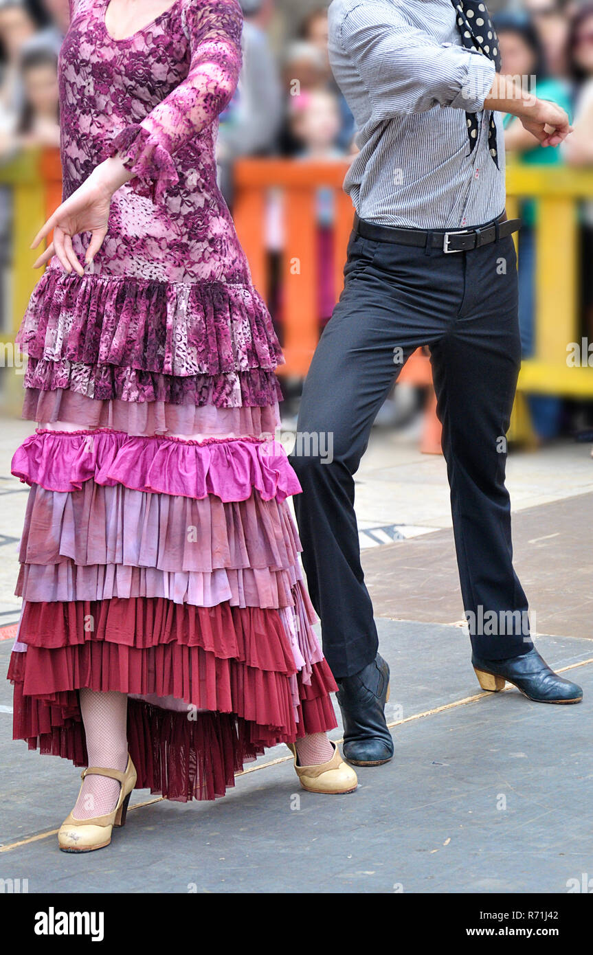 Two Flamenco dancers dancing in a show on the street - Stock Image