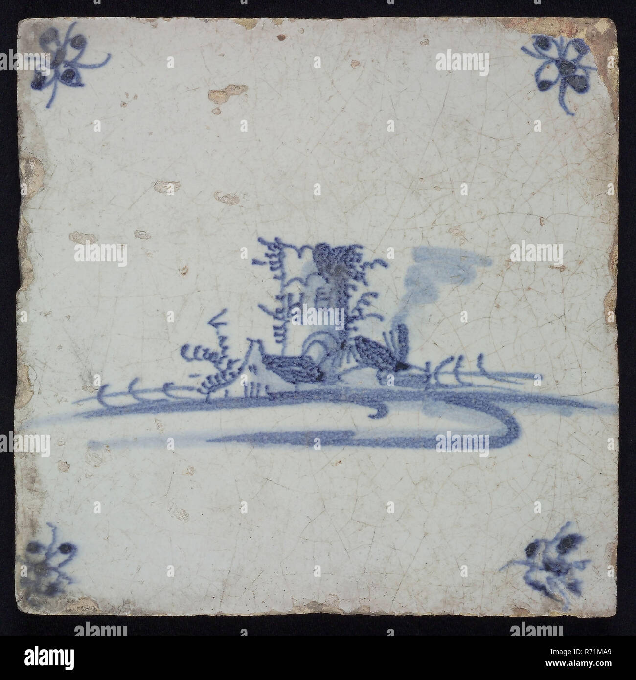 Tile, landscape with ruin or tower, blue decor on white ground, corner fill spider, wall tile tile sculpture ceramic earthenware glaze tin glaze, in form made baked glazed painted baked Wall tile with blue decor on white background Central representation of ruin or tower in stylized polder landscape. Yellow shard Slightly slanted sides of indigenous pottery - Stock Image