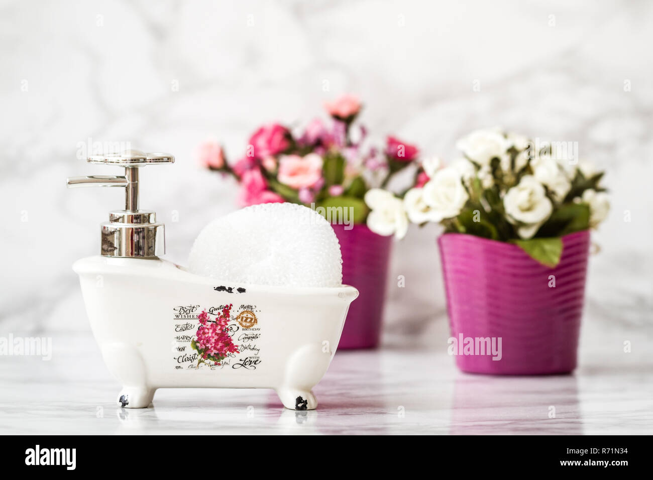 Decorative Ceramic Mini Claw Foot Bathtub Soap Dish with Bath Sponge - Stock Image