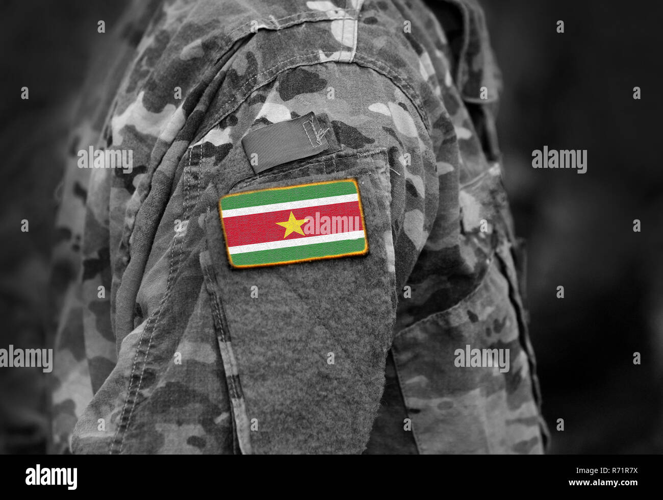 Flag of Suriname on soldier arm. Flag of Suriname on military uniforms (collage). Stock Photo