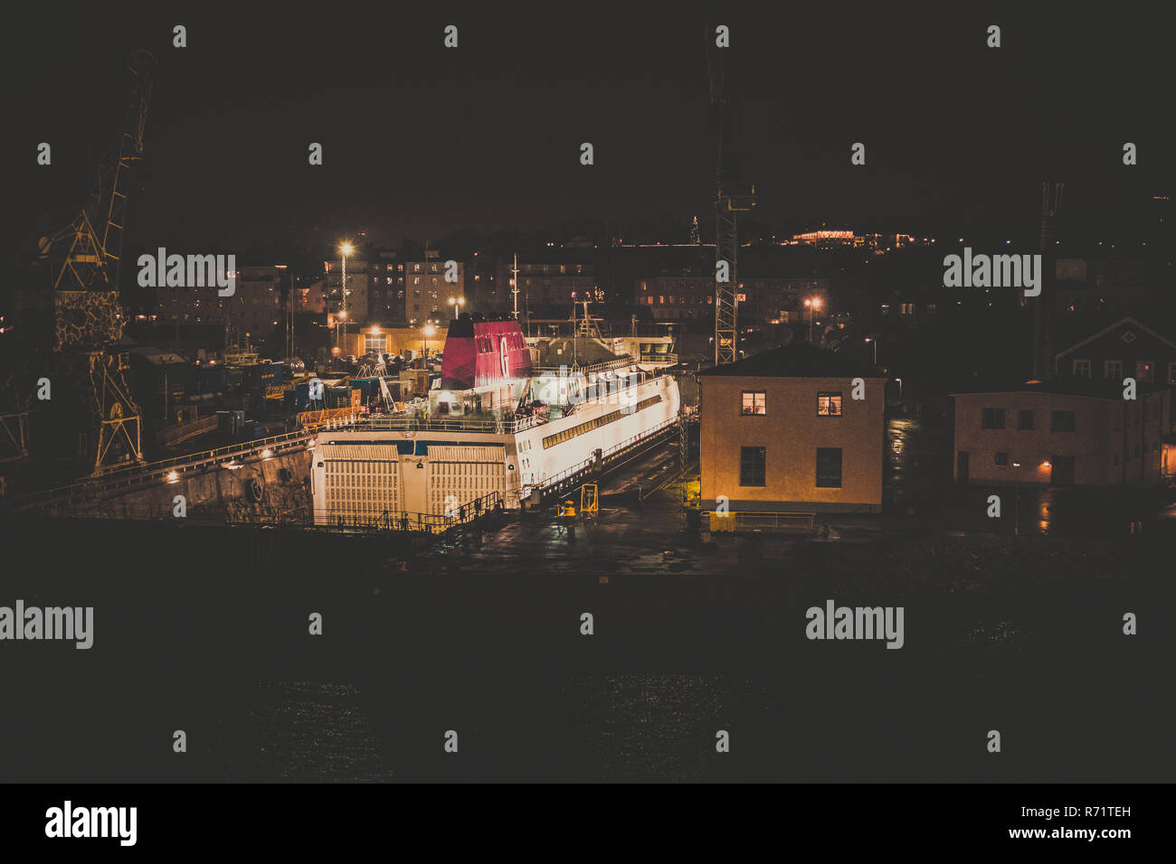 Editorial 11.30.2018 Stockholm Sweden, car ferry in the dry dock for yearly maintenance, seen in the early morning before sunrise - Stock Image