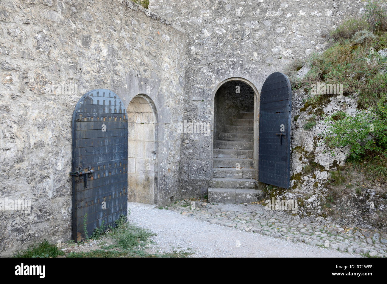 Metal Security Doors, Arched Doorways & Cobbled Path in the Medieval Citadel, Castle or Fortress Sisteron Alpes-de-Haute-Provence Provence France - Stock Image