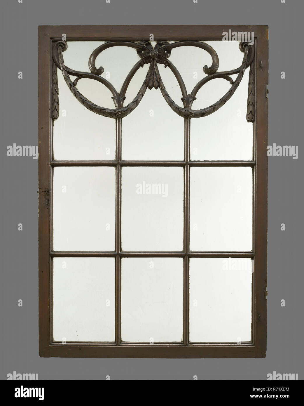 Painted and carved wooden window with nine windows, the top three framed with garlands, window window wood paint, d 3.0 - Stock Image