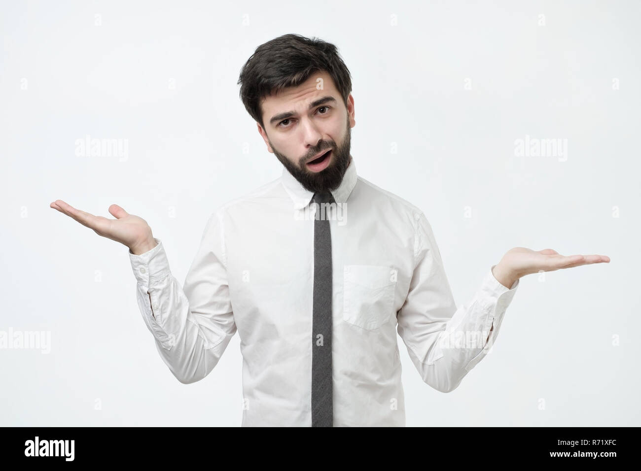 Who knows and it was not me concept. Puzzled bald caucasian man is not sure in his testimony. - Stock Image