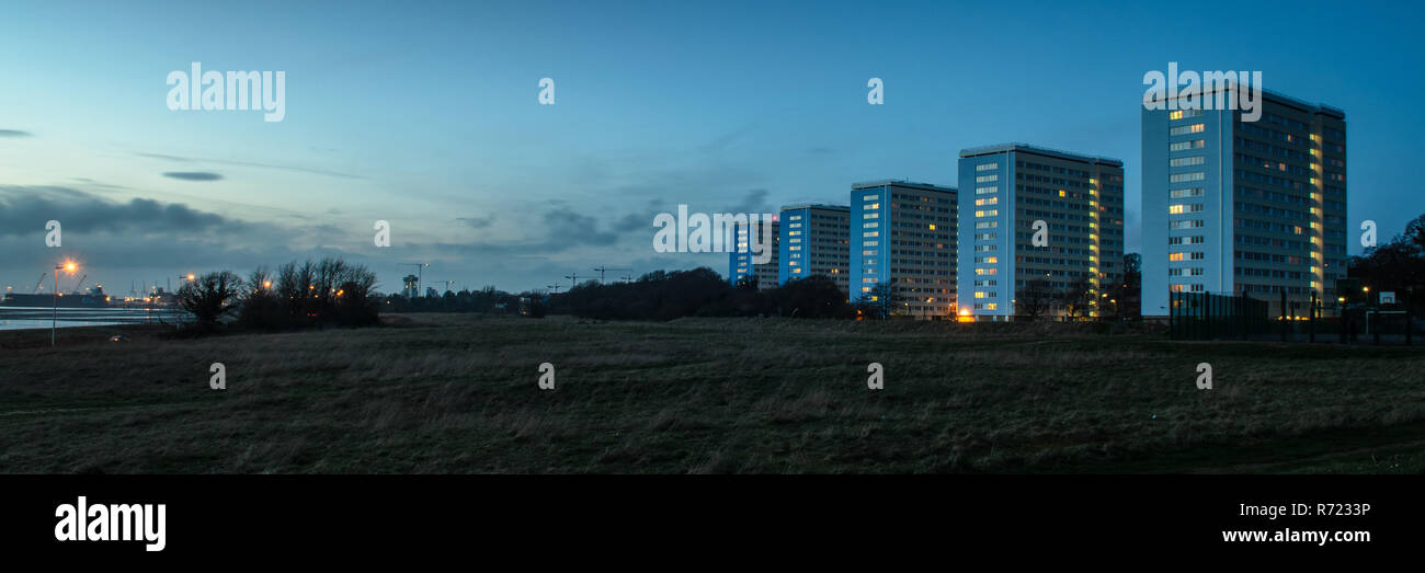 Southampton, England, UK - February 16, 2014: A row of five mid-20th century social housing apartment blocks stand in parkland at Weston Shore beside  - Stock Image