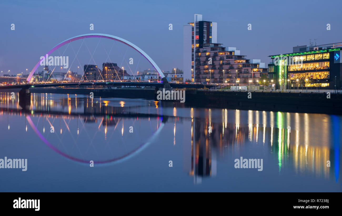 Glasgow, Scotland, UK - November 5, 2018: The Clyde Arc bridge and the offices and studios of STV are reflected in the waters of the River Clyde in Gl Stock Photo