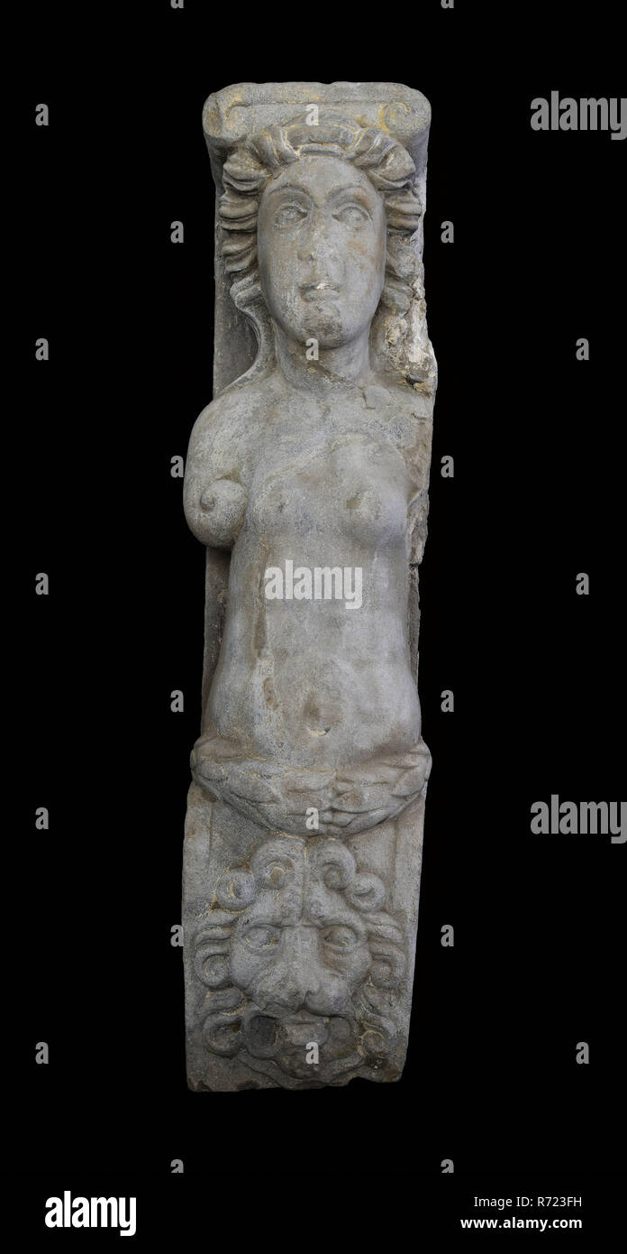 Fragment of caryatid, caryatid building element sculpture footage sandstone stone, sculpted Caryatid with Ionic capital Arms abstracted into curls around the waist leaf. Bottom section is pillar: at the top of lion's head the rest is missing. - Stock Image