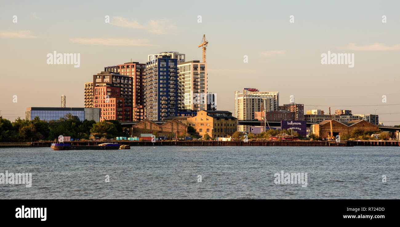 London, England, UK - September 2, 2018: A cluster of modern high-rise new-build apartment buildings nears construction completion at Bow Creek in the - Stock Image