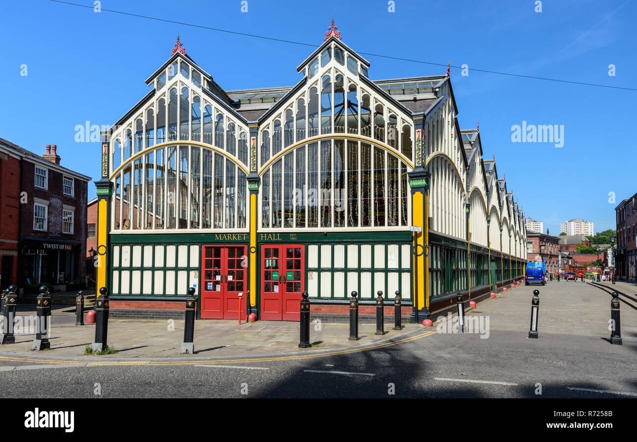 Stockport, England, UK - July 2, 2018: Sunshine illuminates the traditional Victorian Market Hall and cobbled Market Place of Stockport in Greater Man - Stock Image