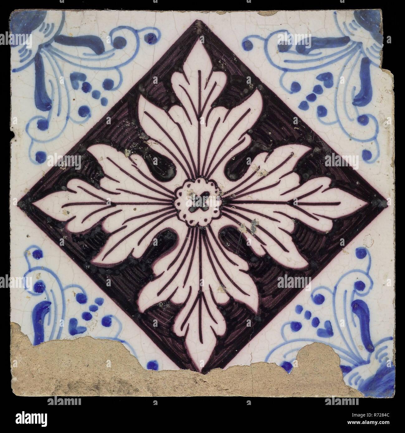 Ornament tile, symmetrical leaf shape, corner motif, ox head, wall tile tile sculpture ceramic earthenware glaze, baked 2x painted glazed Square yellow shard with bevelled side. Purple and blue on white fond tile bakery Piet Heijn - Stock Image