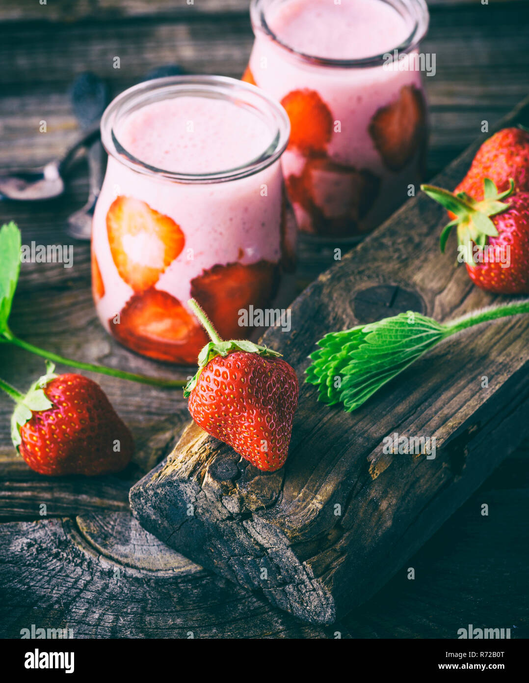 red strawberry and two glass jars of smoothies Stock Photo