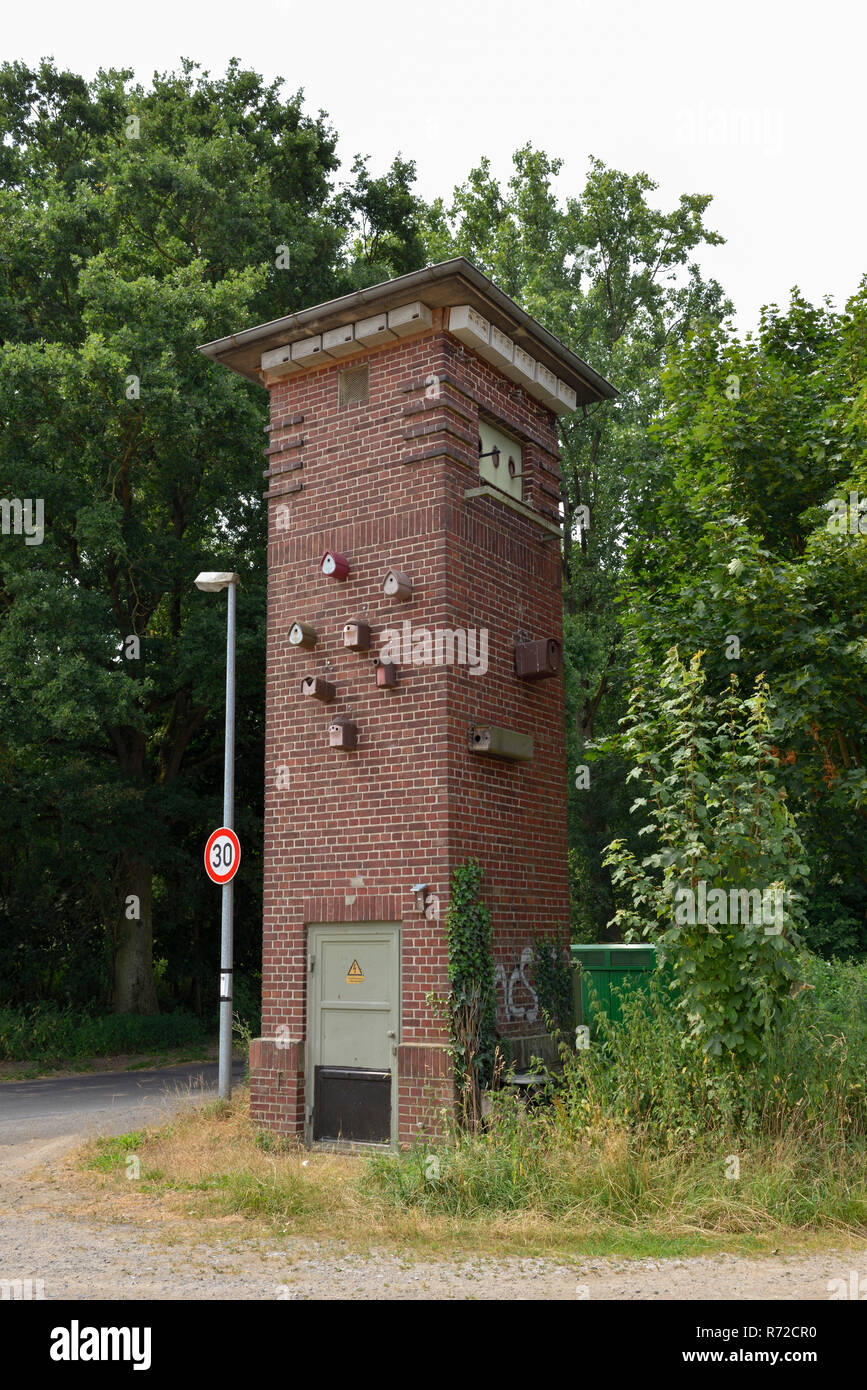 Old transformer station recontructed to a wildlife station, nesting boxes attracting different kinds of birds, owls, falcons, bats and others, Europe. - Stock Image