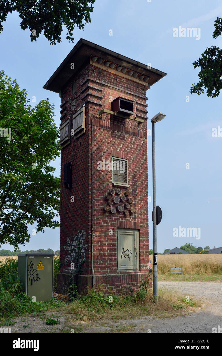 Old transformer station recontructed to a wildlife station, attracting different kinds of birds like swallows, owls, falcons, bats and also insects, E - Stock Image