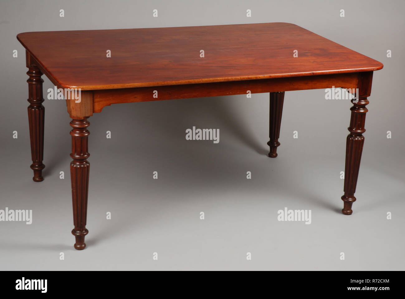 Rectangular mahogany table table furniture interior design mahogany wood rounded corners and four fluted tapered legs
