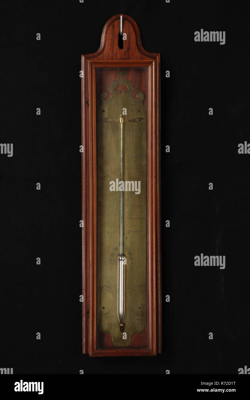 A. Reballio, Thermometer with engraved brass plate with glass thermometer tube and three different temperature scales from Réaumur, La Court and Fahrenheit, thermometer measuring instrument wood mahogany glass brass iron mercury h 60.0, cabinet thermometer An elongated mahogany cabinet with elongated glass door contains an engraved brass plate with glass mercury column on the plate shell - and leaf ornaments indications of temperature for which three different scales and signature At the scale in Fahrenheit at the respective temperatures are also experience types and location notifications whe - Stock Image