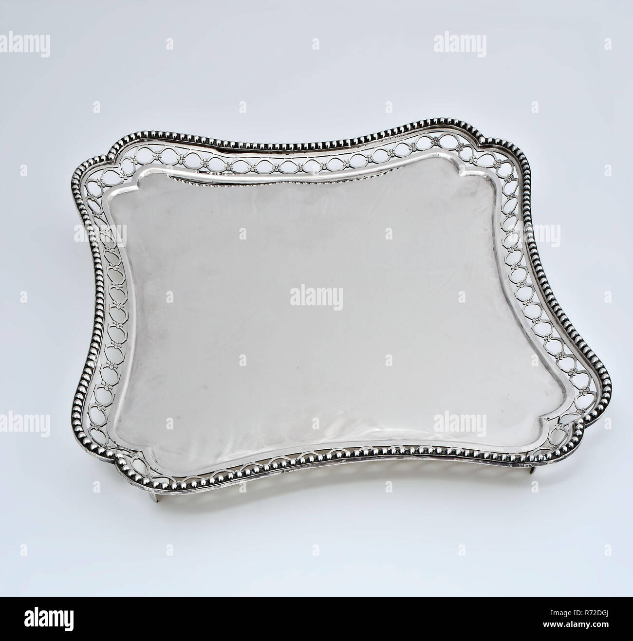 Silversmith: Cornelis Knuijsting, Square silver tray on legs with openwork edge, tray leaf holder silver, cast sawn Square leaf with swiveling side edges and brace-shaped curved corners on four smooth legs bottom bottom (debossed) serving - Stock Image
