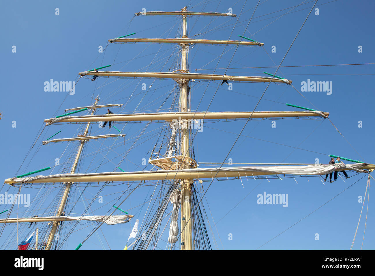 Crews working in the rigging of two tall ships during the 2018 Tall Ships Race in Sunderland - Stock Image