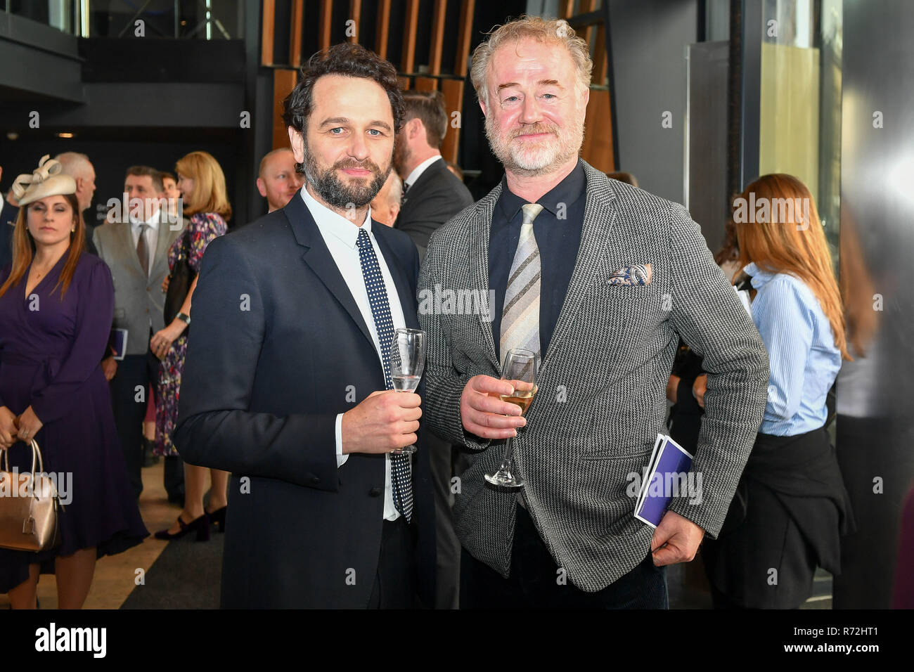 Actors Matthew Rhys (left) and Owen Teale attend a reception at The Royal Welsh College of Music & Drama. - Stock Image