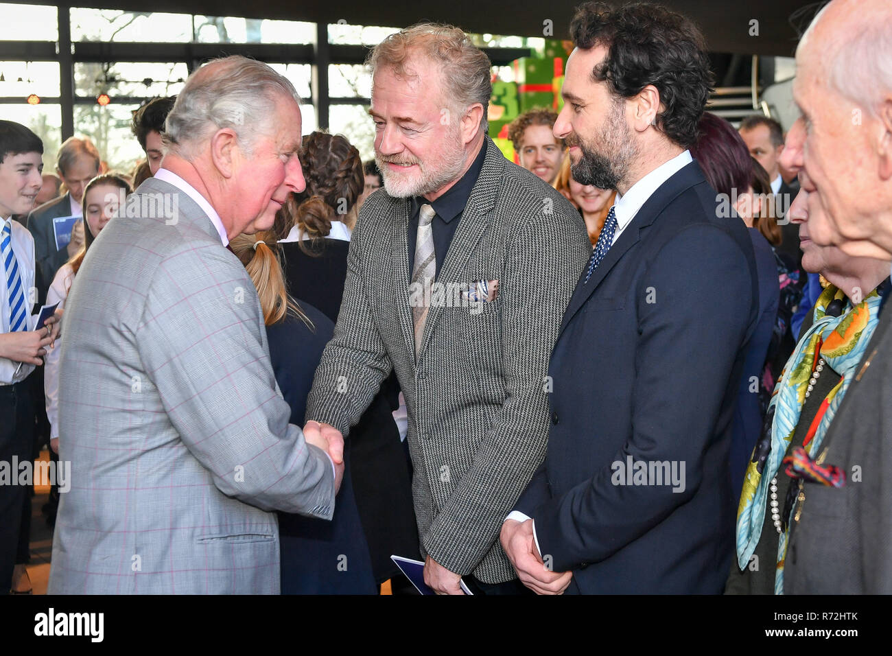 The Prince of Wales talks to actors Owen Teale and Matthew Rhys (right), at the Royal Welsh College of Music & Drama, where he is attending a special performance and reception. - Stock Image