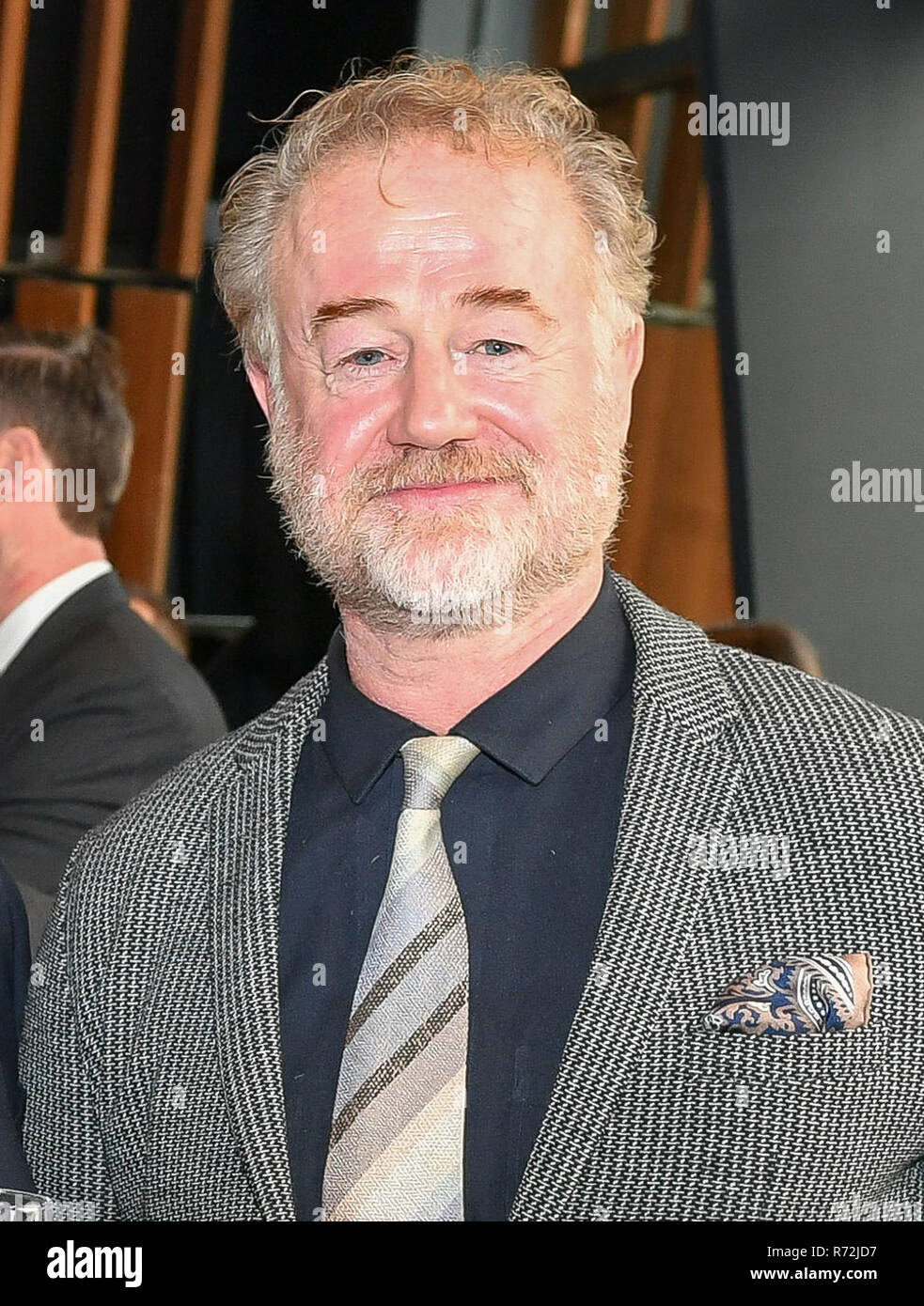 Actor Owen Teale attends a reception at The Royal Welsh College of Music & Drama in Cardiff. - Stock Image