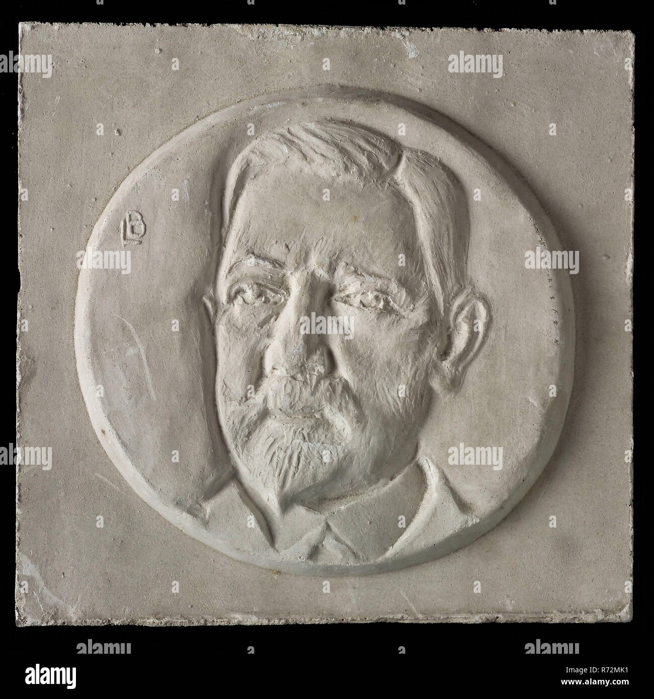 Leendert Bolle, Two halves of mold for Medal, respectively high and low relief, within circle man's portrait with beard and mustache, for three quarters, mold casting sculpture gypsum, left above signed LB Rotterdam - Stock Image