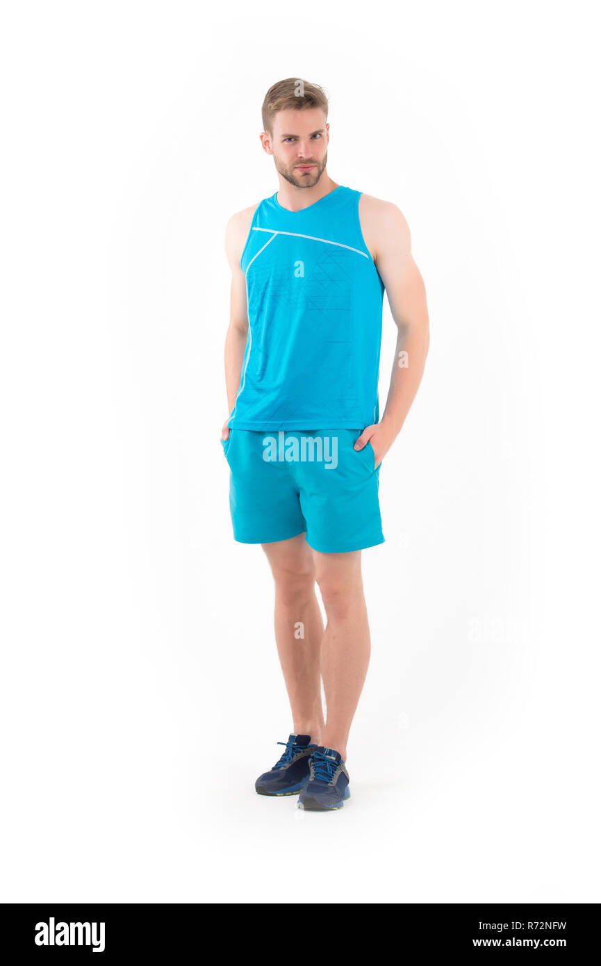 Sportsman in active wear and shoes for running isolated on white background. Bearded man in blue sport clothes and sneakers. Sport fashion style and trend. Training and workout activity. Stock Photo
