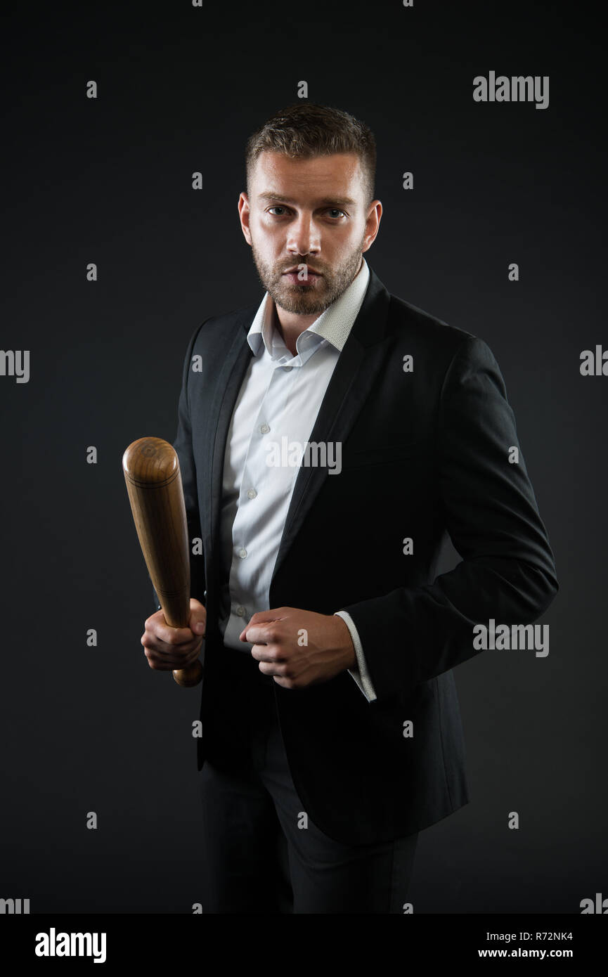 Bearded man hold baseball bat. Businessman with bat weapon. Aggression or ambitions and violence concept. Business fashion and style. - Stock Image