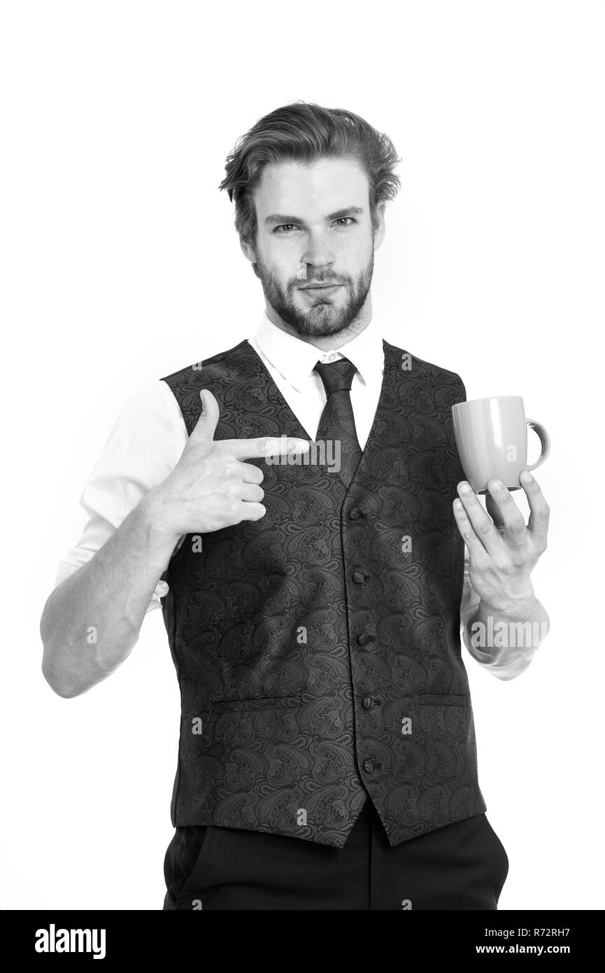 elegant man in waistcoat with a cup of coffee isolated on white background - Stock Image