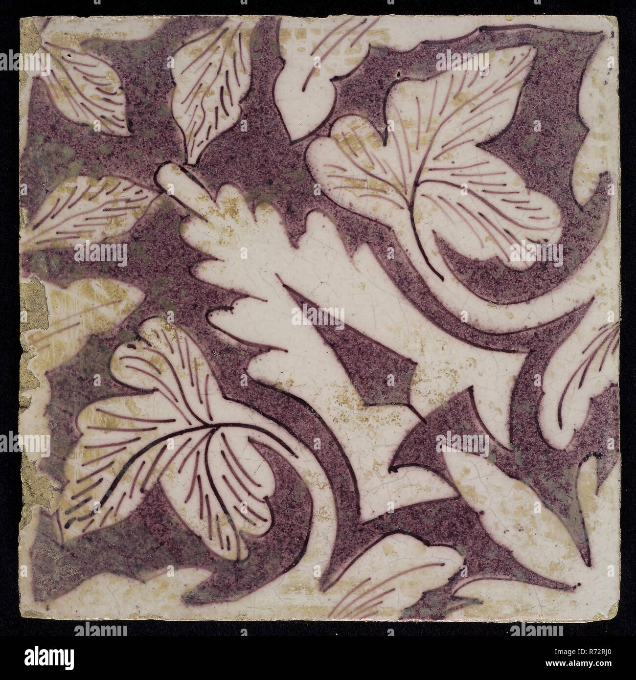 Sprinkled purple ornament tile, openwork stylized pointed leaves coming from corner, surrounded by creeper leaves, oak leaves, wall tile tile material ceramic earthenware enamel, Baked 2x glazed painted Yellow shard square two nail holes. Purple on white. Stock Photo