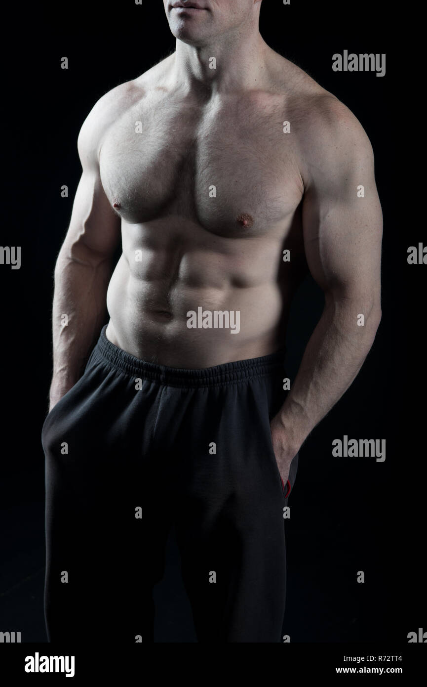 Torso with six pack and ab muscles. Torso with fit belly and athletic chest. - Stock Image