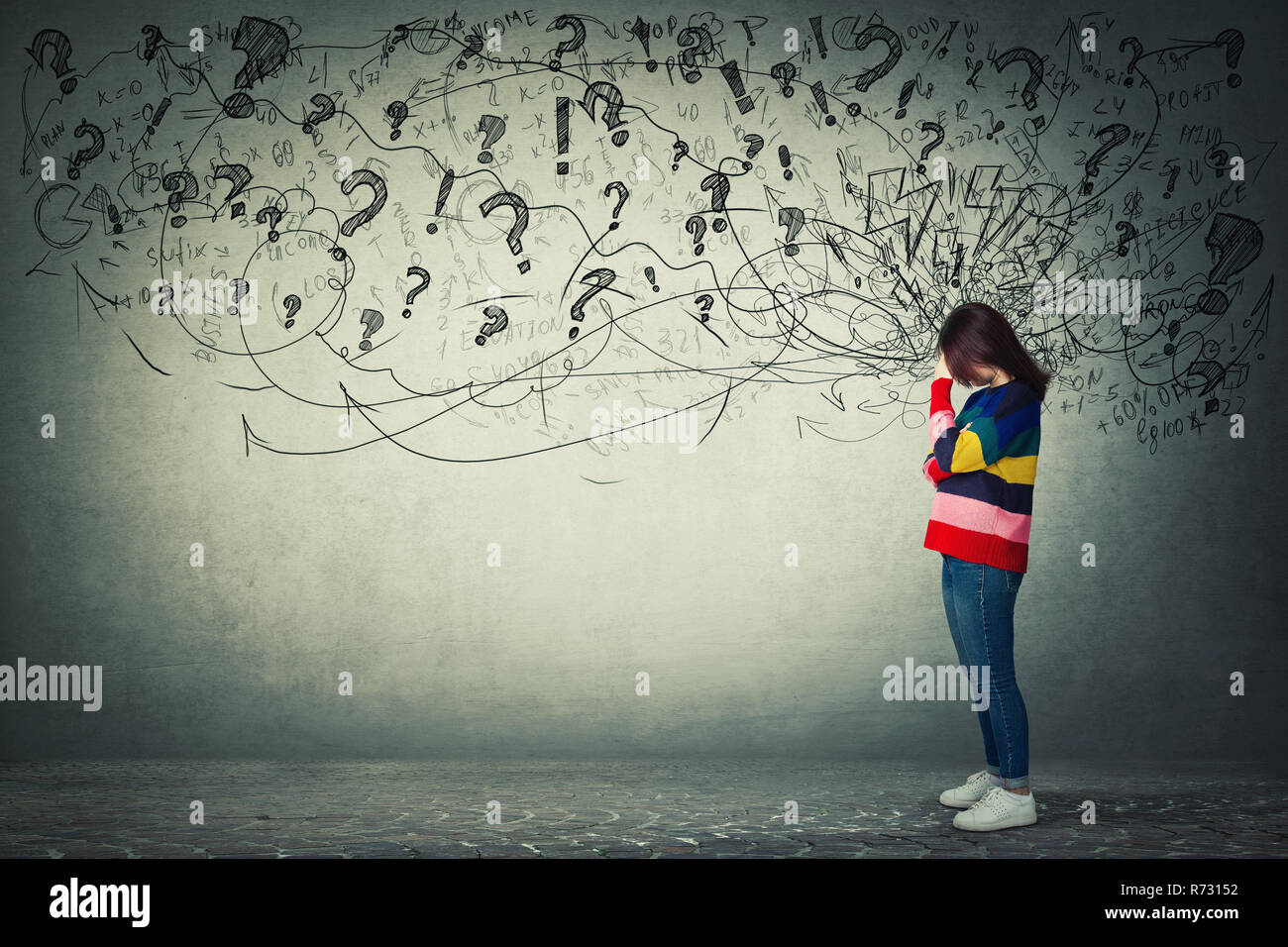 Side view full length portrait of worried young woman holding hand to forehead. Thoughtful stressed girl sad meditative emotion with a mess in her hea - Stock Image