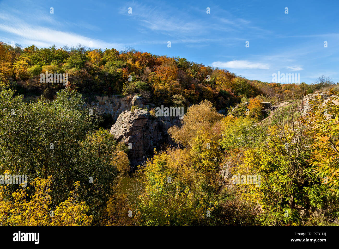 Nature In the Autumn of the Beech Canyon, Ukraine. Interesting places and travels in Ukraine. The Mountain Tikich River flows in Proterozoic granites, - Stock Image