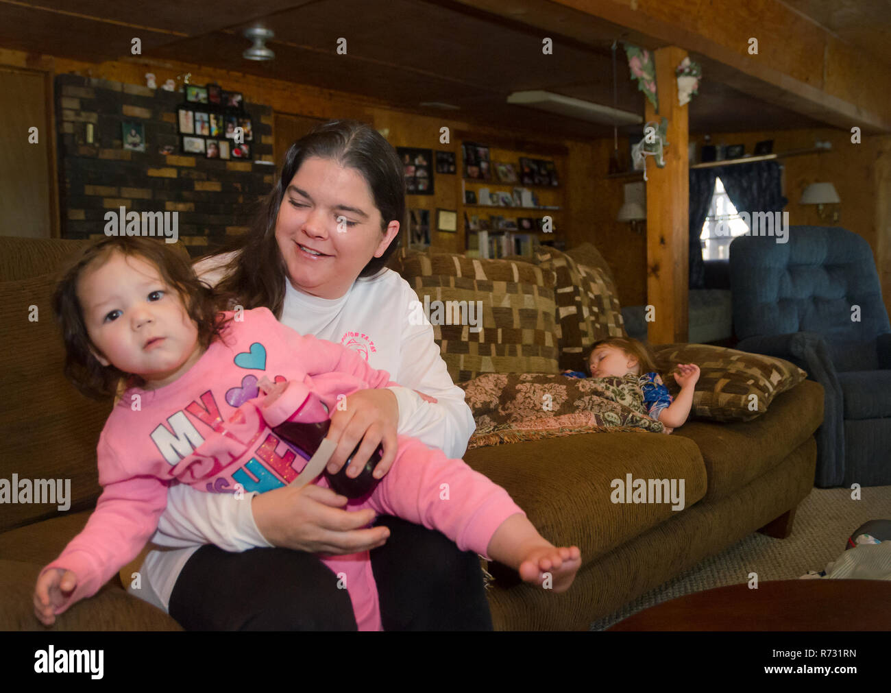 Former day care worker Sara Morales holds her daughter, 18-month-old Carleigh Morales, March 4, 2016, at her home in Loxley, Alabama. Stock Photo