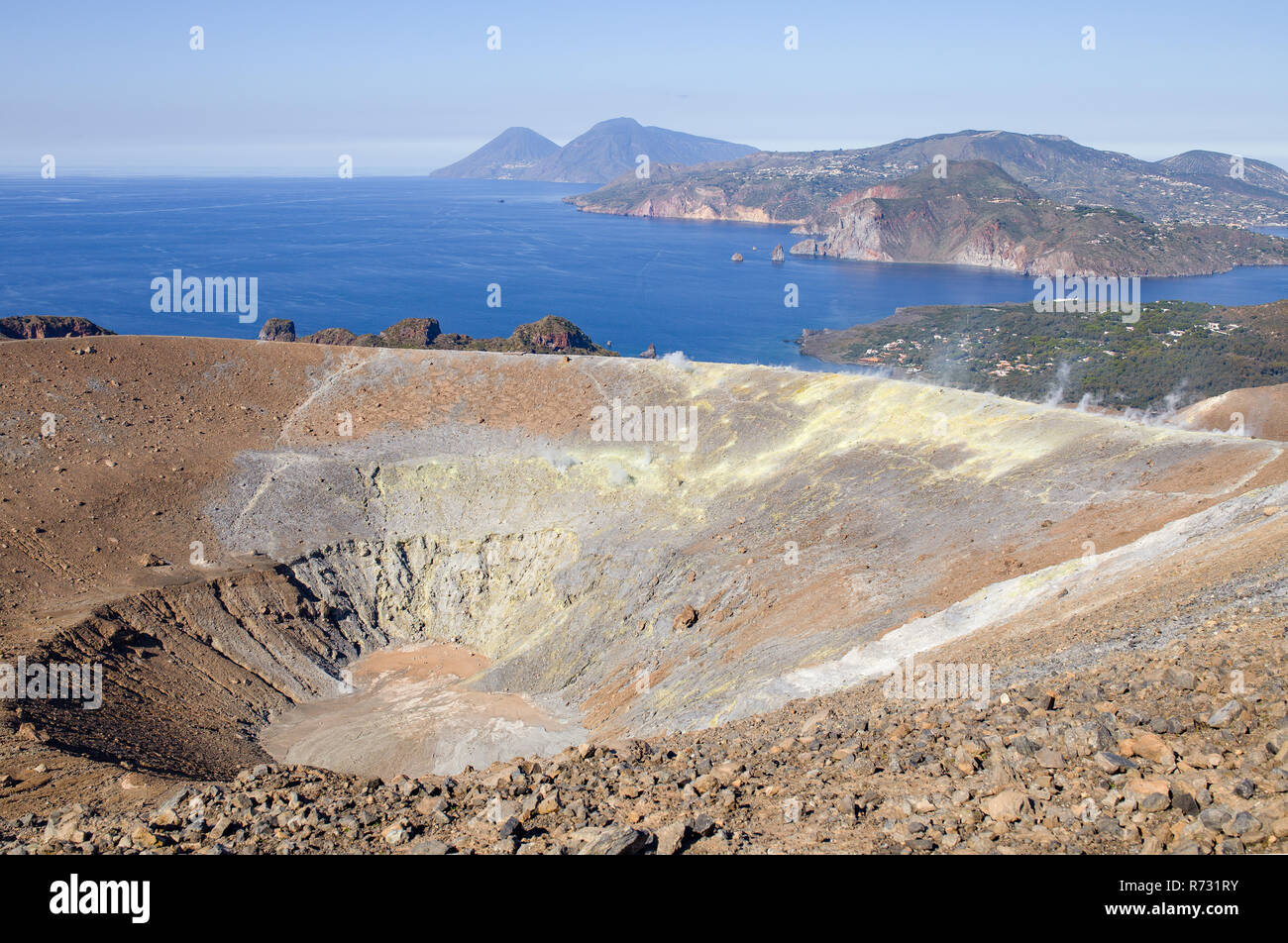The volcano crater, Aeolian Islands. In the background Mediterranean Sea and blue sky. Area of Sicily, Italy. - Stock Image