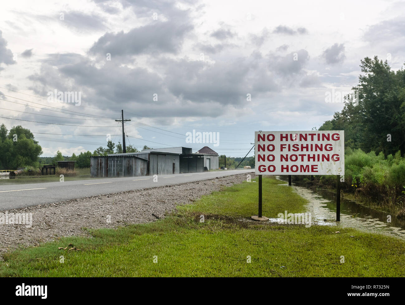 A sign discourages visitors at Motiva Enterprises, an oil refinery in Convent, Louisiana. Motiva also owns refineries in Norco, Louisiana, and Texas. - Stock Image