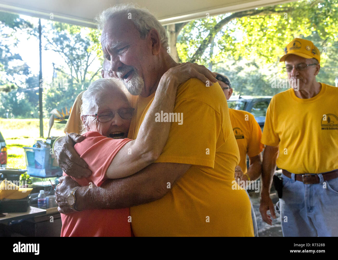 A flood victim hugs a Southern Baptist Disaster Relief volunteer after a flood in Baton Rouge, Louisiana. - Stock Image