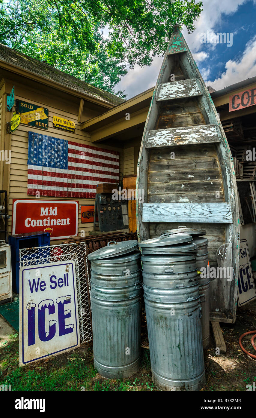 Vintage advertisements and other items are stacked stacked Biggar's Antiques in Chamblee, Georgia, June 10, 2014. - Stock Image