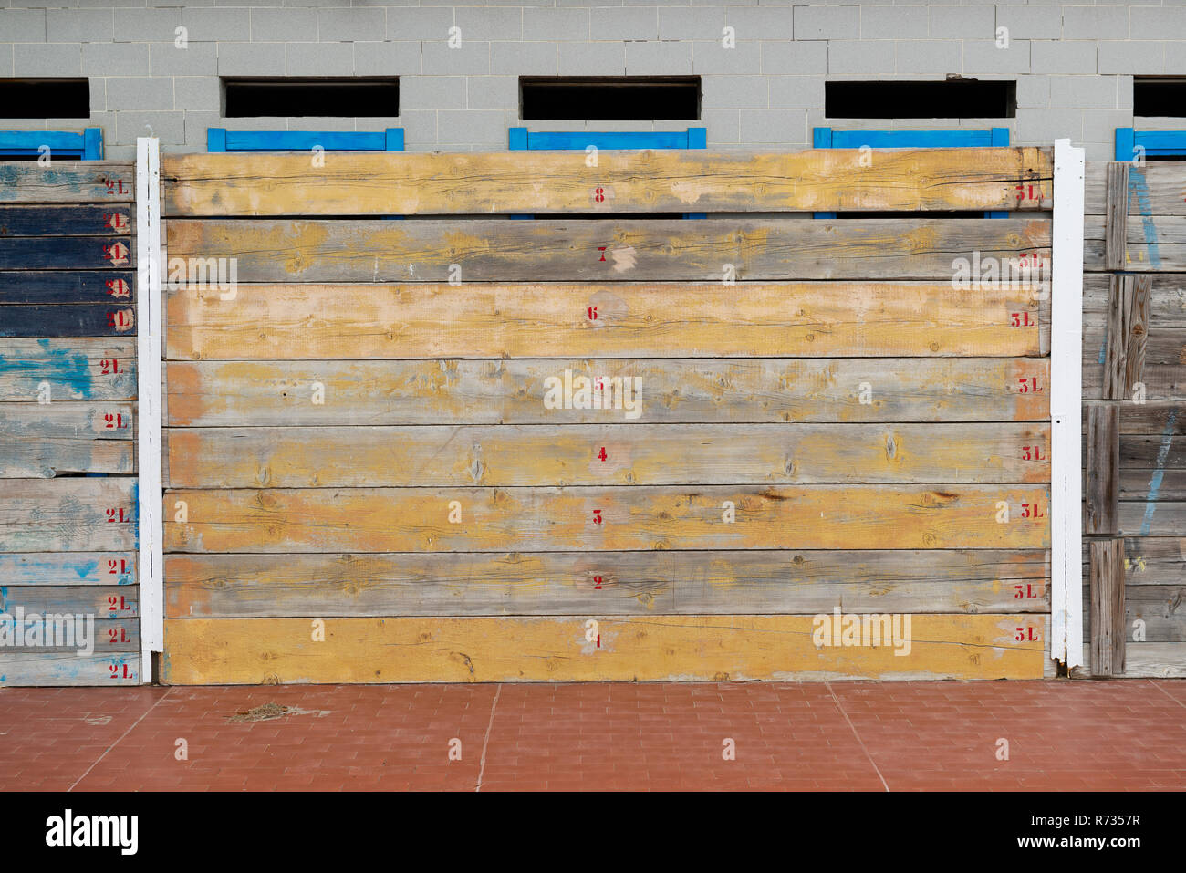 Facades covered with wooden planks to protect against winter weather and storms of the sea, and by possible malicious thieves - Stock Image